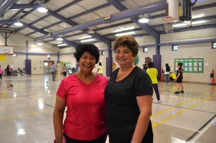 Zumba enthusiast Laura Salazar stands with SAISD Board member Olga Hernandez before a recent session at Rogers Elementary School. Photo by Iris Dimmick.