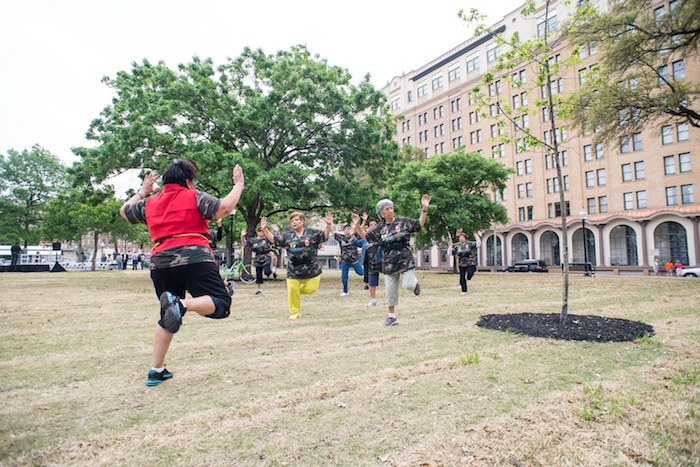 The San Antonio Parks and Recreation department's Fitness in the Park program, as demonstrated by local participants during the grand re-opening ceremonies, will be a reoccurring event at Travis Park. Photo by David Rangel.