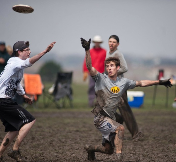 Michael Goodgame during a particularly muddy game of Ultimate Frisbee. Photo by Niko Duffy.