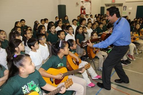 Maverick Elementary School music teacher Paul Perea leads students in a guitar lesson at Maverick Elementary School.