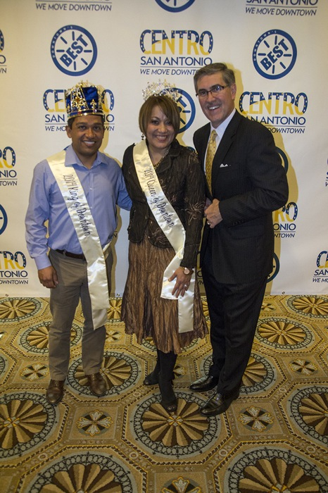 King Snow Montemayor and Queen Rose Taylor stand with Centro San Antonio CEO Pat DiGiovanni.
