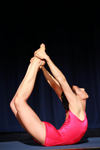 "San Antonian Katherine Mondloch-Seavey performs one of the five compulsory asanas, ""The Bow,"" during the 2014 National USA Yoga Asana Championship at the Aztec Theatre. Photo courtesy of USA Yoga Federation."