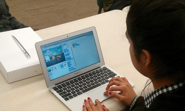 """Teens learn the basics of computer programming through an MIT educational program, """"Scratch,"""" at Great Northwest Branch Library. Photo by Andrew Moore."""