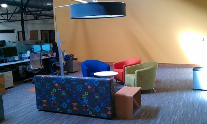 The office has five of these informal work/meeting areas, if employees are tired of working at the desk