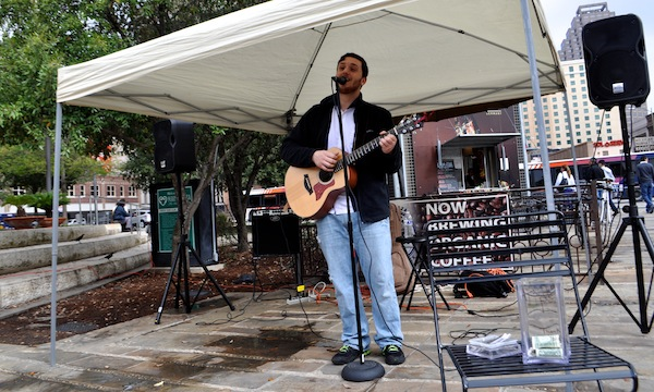 Ponciano Seoane III plays for Main Plaza inhabitants during the Farmers Market. Photo by Iris Dimmick.