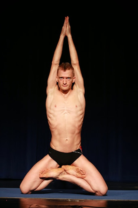 """Adult Male First place recipient Zeb Homison executes the """"Mountain"""" pose during the 2014 National USA Yoga Asana Championship at the Aztec Theatre March 14-16. Photos by Stacy Pape/USA Yoga Federation."""