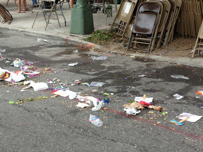 Trash on the street after the Battle of Flowers parade 2013. Photo by Randy Bear.