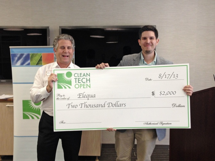 Mitch Jacobson of Austin Technology Institute presents Ryan Beltrán of Elequa a check for $2,000 at the 2013 Regional Cleantech Open competition. Elequa won the sustainability award in the CTO south-central region. Courtesy photo.
