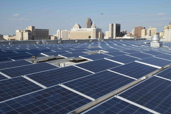 The San Antonio skyline beyond rows of solar panels. Photo courtesy of UTSA.