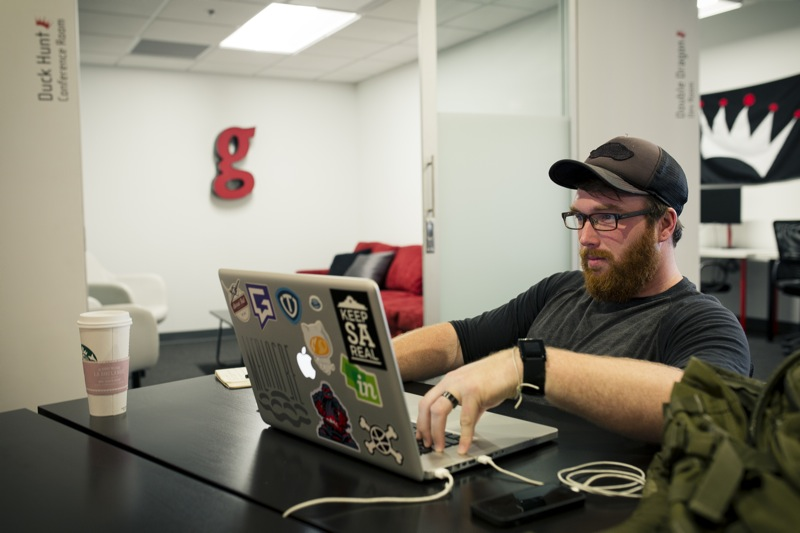 Chris Welch of Barrel Roll Creative works in the new Geekdom co-working space in the Rand Building. Photo by Kara Gomez.