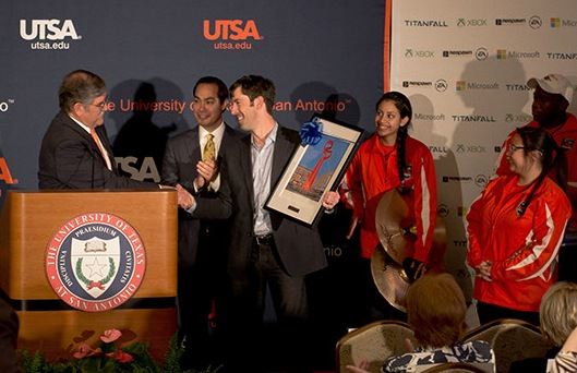 UTSA President Ricardo Romo and Mayor Julián Castro present Microsoft Director of Energy Strategy Brian Janous with a photo of the Torch of Friendship during the UTSA-Microsoft collaborative announcement. Photo by Mark McClendon of UTSA.