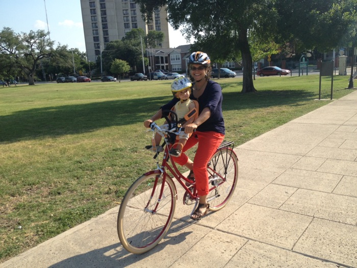 """Anna """"Mama"""" CohenMiller riding with the little guy in San Pedro Park. Courtesy photo."""