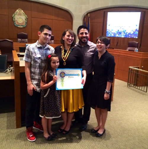 San Antonio Poet Laureate Laurie Ann Guerrero poses for a photo with her family in City Council chambers during her official appointment ceremony. Photo by Melanie Robinson.
