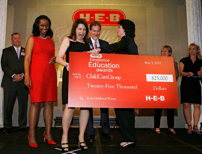 Early Childhood award winner ChildCareGroup represented by Victoria Mannes receives their check at the HEB Excellence in Education Awards at the Grand Sonesta Hotel in Houston, Texas Saturday May 3, 2014. Photo courtesy of H-E-B.