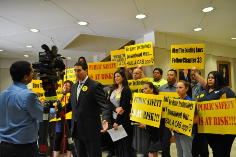 John Bouloubasis, president of Yellow Cab San Antonio, speaks with media after the City Countil Public Safety Committee meeting May 7, 2014. Photo by Iris Dimmick.