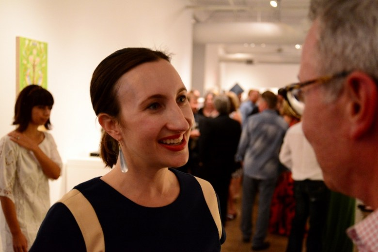 Mary Heathcott talks with a patron at Blue Star Red Dot. Photo by Page Graham.