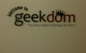 The Geekdom sign, on the wall on the 11th floor at the Weston Centre. It has since moved its offices to the Rand Building, a block away. Photo by Lily Casura.