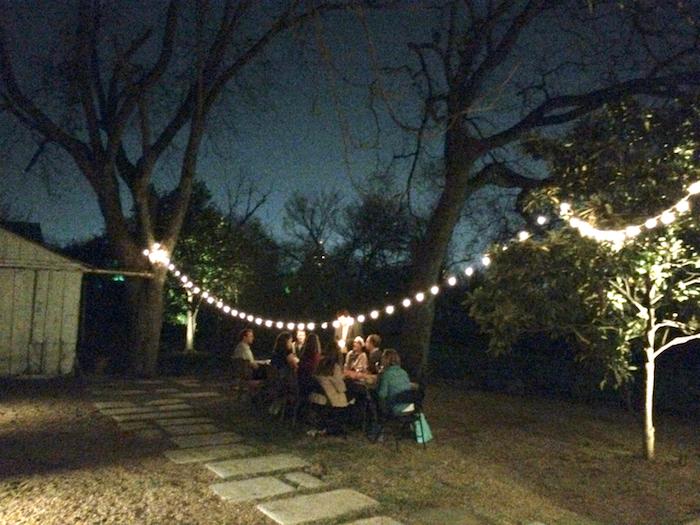 Guests enjoy dinner in the McNeel backyard in Dignowity Hill. Photo by Lewis McNeel.