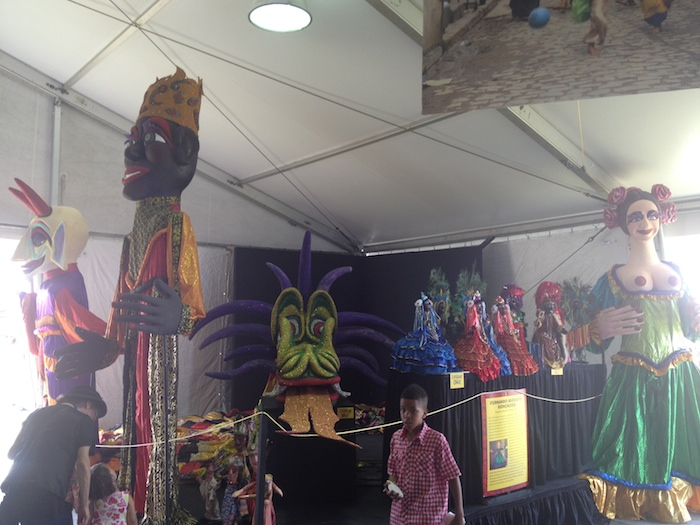 A peek inside the Cultural Exchange Tent for Brazil, featuring the famous giant paper mache figurines for parade time. Photo by Adam Tutor.