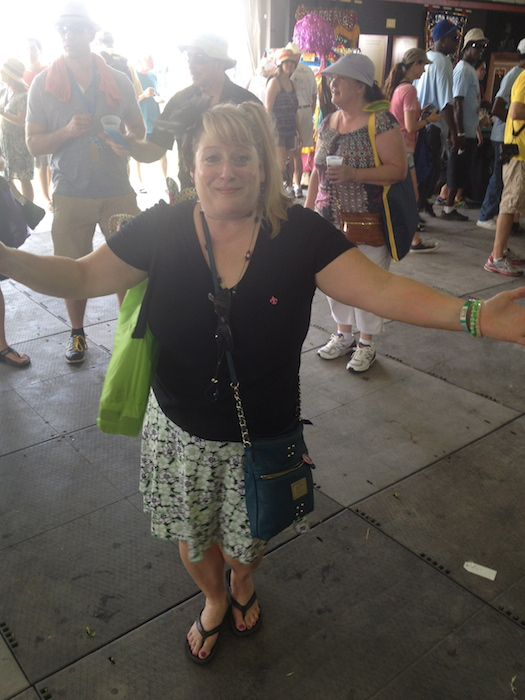 """A true Cajun woman and representative of the festival fare, Lil' Wheezy loved to spice up the afternoon with her """"magic potion."""" Photo by Adam Tutor."""