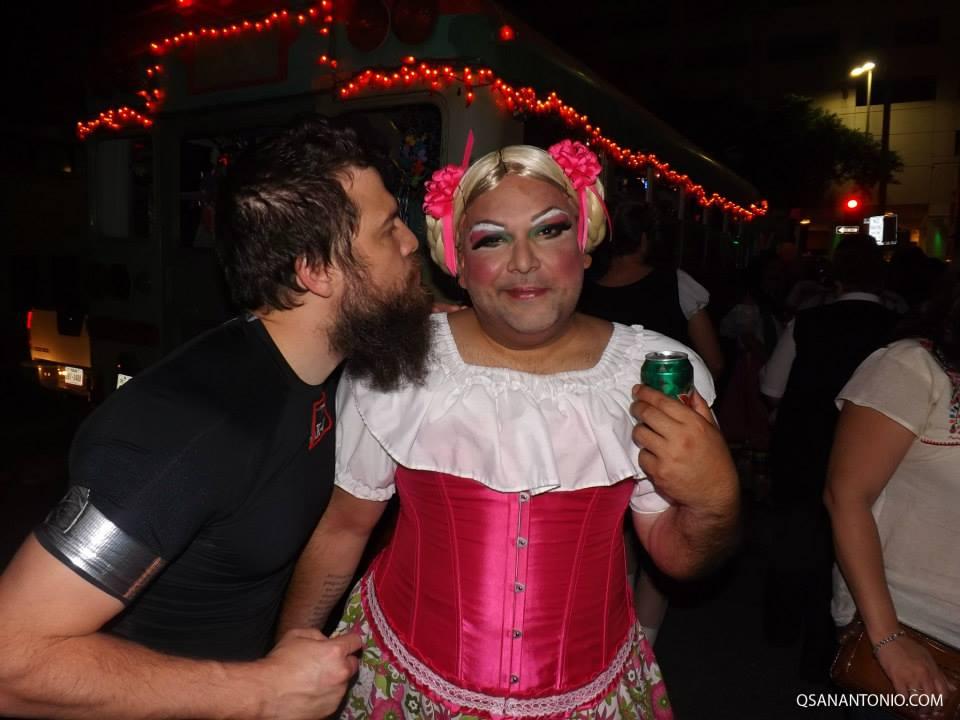 Cornyation 2014 performer Rick Gipprich Jr (right), gets a drink and kiss during Cornyation 2014. Photo courtesy of QSanAntonio.com.