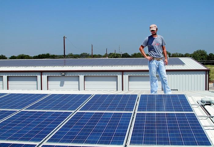 SRS Employee Drew surveys a recent solar energy installation at Green Acres Golf in San Antonio. Photo courtesy of Self Reliant Solar (SRS).