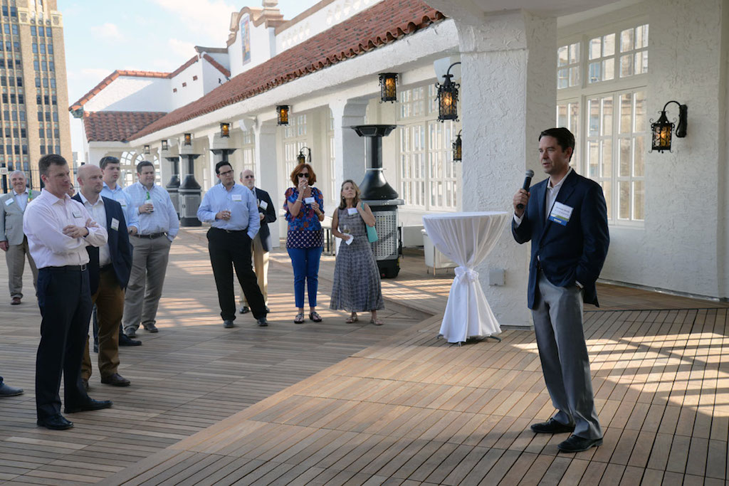 Brandon S. Raney, chief executive officer of BC Lynd Hospitality, speaks to guests of the Urban Land Institute Project Tour about his company's $24 million renovation of the St. Anthony Hotel. Photo by Annette Crawford.