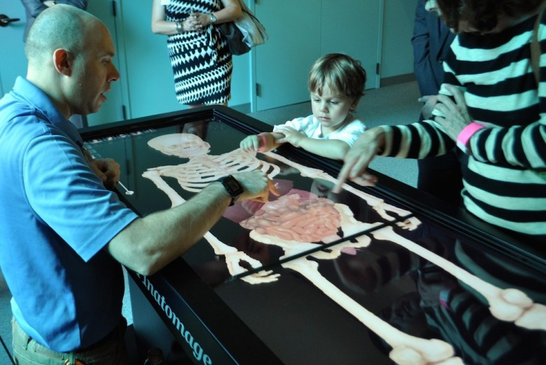 A child interacts with the anatomy table during the Witte Museum H-E-B Body Adventure media preview event May 23, 2014. Photo by Iris Dimmick.