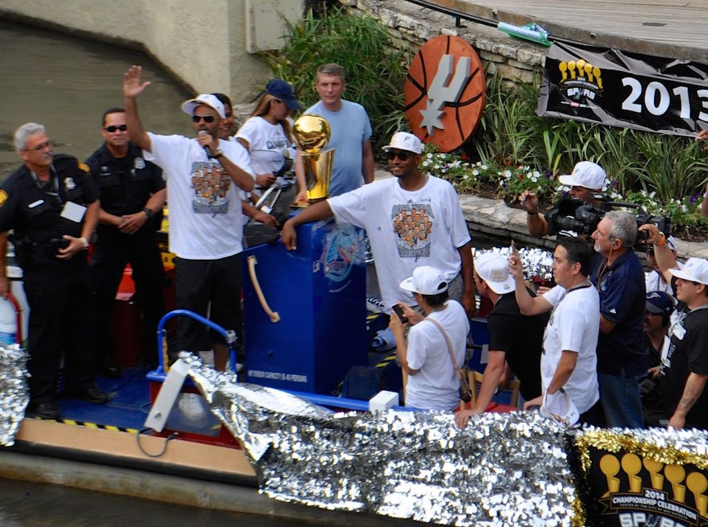 Spurs Tim Duncan and Boris Diaw address the crowd at the Arneson River Theatre during the 2014 Spurs Championship River Parade on June 30, 2014. Photo by Iris Dimmick.