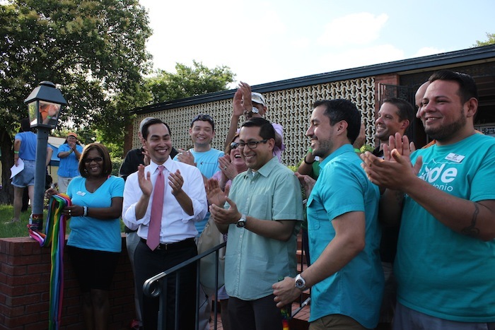Mayor Julián Castro (center left) and District 1 Councilman Diego Bernal (center right) applaud the Pride Center San Antonio after cutting the rainbow ribbon. Photo by Melanie Robinson.