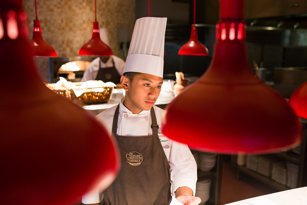 Chef Julius prepares for customers to arrive for dinner at Nao. Photo by Scott Ball.