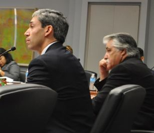 District 8 Councilman Ron Nirenberg (left) and District 6 Councilman Ray Lopez look on as CPS Energy presents its case for a solar grid fee during B Session on June 11, 2014. Photo by Iris Dimmick.