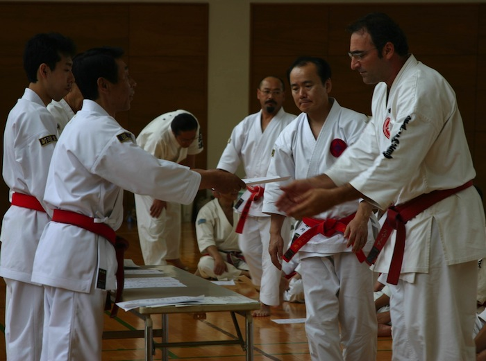 Winslow Swart receiving 6th dan master instructor certification from Kenseido grand master Akizuku Takayoshi in Kashima japan in 2006. Courtesy photo.