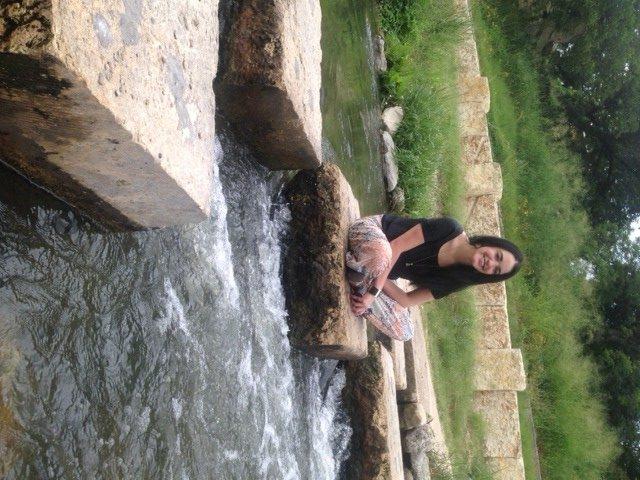 """Anali Barrera in her """"zen spot,"""" a rock bridge on the San Antonio River. Courtesy photo."""