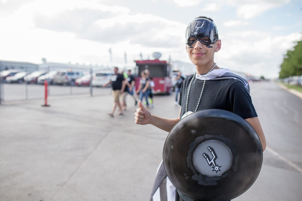 Super Spurs fan Jorge Lozano poses for a photo on his way to Game 1 of the 2014 NBA Finals. Photo by Scott Ball.