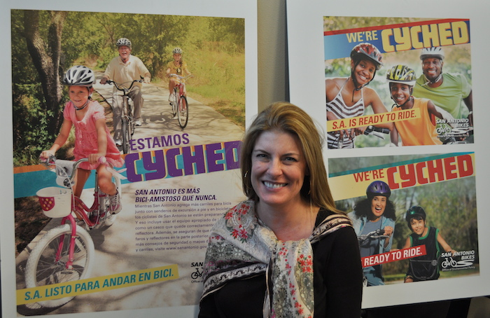 Julia Murphy at SA Bikes with new safety campaign posters in 2012. Photo by Iris Dimmick.