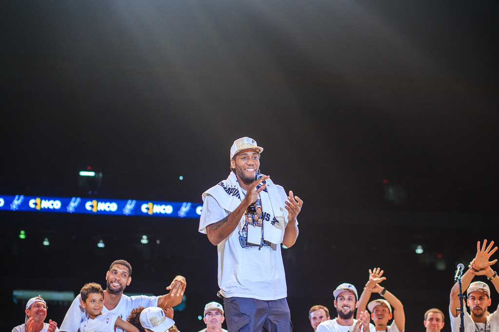 Kawhi Leonard appeases a packed stadium during the Spurs celebration at the Alamodome of their 2014 NBA Finals victory. Photo by Scott Ball.