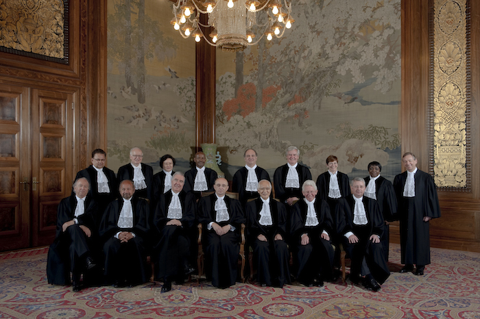 Members of the International Court of Justice (new composition, as from 27 April 2012) at the foot of the grand staircase of the Peace Palace. Photograph: ICJ-CIJ-UN Photo, Rob Ris, Max Koot Studio, July 2012. Courtesy of the ICJ. All rights reserved.