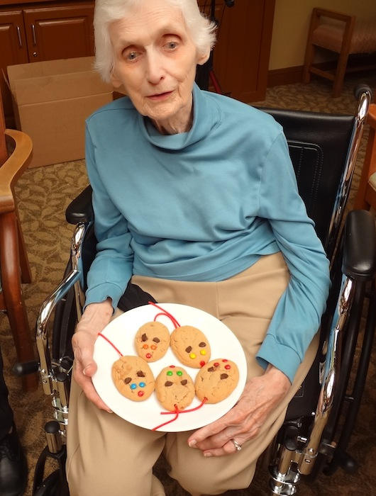 Nora Lee Peterson's mother, Shirley, holds a plate of mouse cookings while being read the Rescuers by Margery Sharp. Author photo.