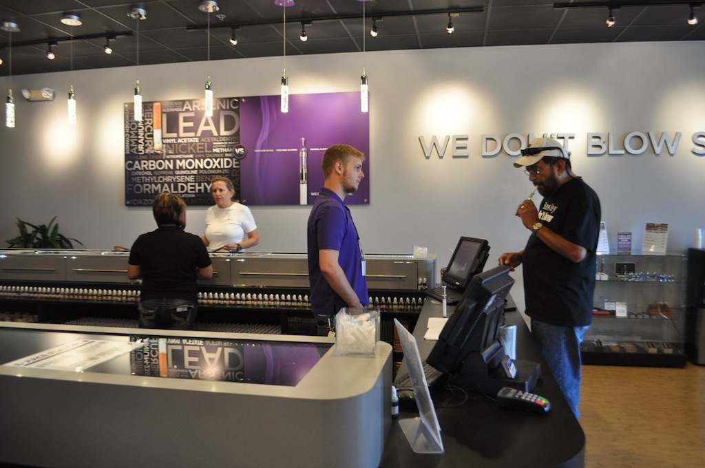 """Patrons at Monster Vape during a recent visit included seasoned """"vapers"""" coming in for refills and curious new-comers. Photo by Iris Dimmick."""