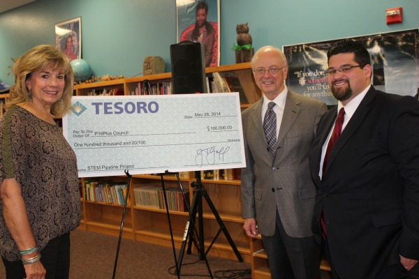 Barbara Stevens, Jim Adams, and Steven Hussain of P16 Plus receive a grant from the Tesoro Foundation.