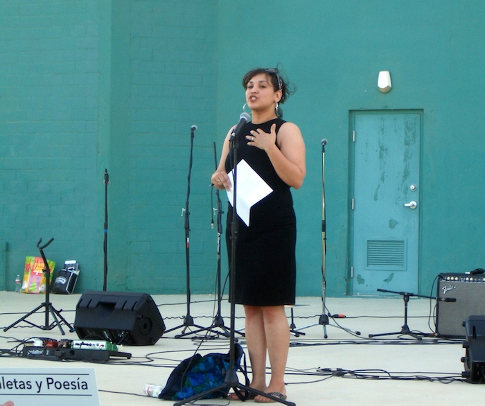 Poet Laureate Laurie Ann Guerrero reads from her work at the Mission Marquee Plaza grand opening June 7, 2014. Photo by Lily Casura.
