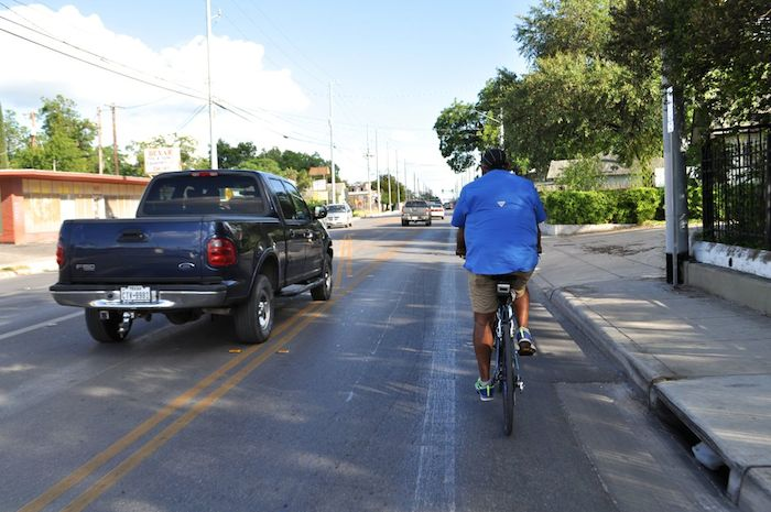 """Motorists use a turning lane to pass cyclists on a section of road without a bicycle lane during the South Flores Street lane removal protest, """"Every Lane is a Bike Lane."""" June 4, 2014. Photo by Iris Dimmick."""