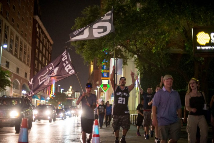 Spurs fans celebrate in downtown San Antonio after the Spurs win the 2014 NBA Finals. Photo by David Rangel.