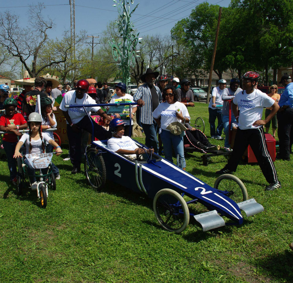 Ivy Taylor participating in the Dignowity Hill Pushcart Derby. Photo by Juan Garcia.