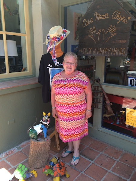 Patricia Stowe stands in front of Casa Manos Alegres, a shop selling folk art at La Villita Historic Arts Village for 43 years. Photo by Katherine Nickas.