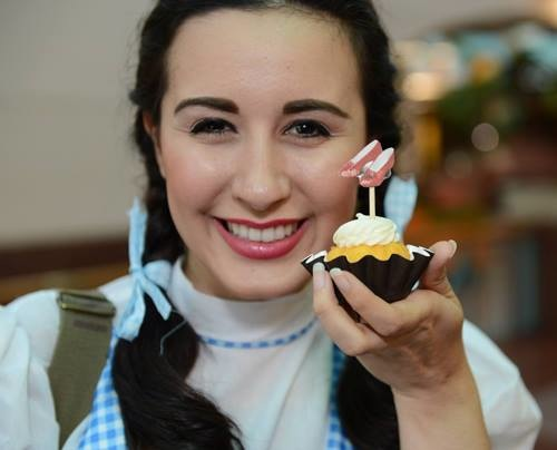 """Kayla Brodnicki, who will play Dorothy in The Playhouse production of """"The Wizard of Oz"""", treated cinema fans to a performance of """"Over the Rainbow."""" Mini-bundtinis provided by Nothing Bundt Cakes at the June 24 screening of """"The Wizard of Oz.""""  Photo from TPR's Facebook page."""