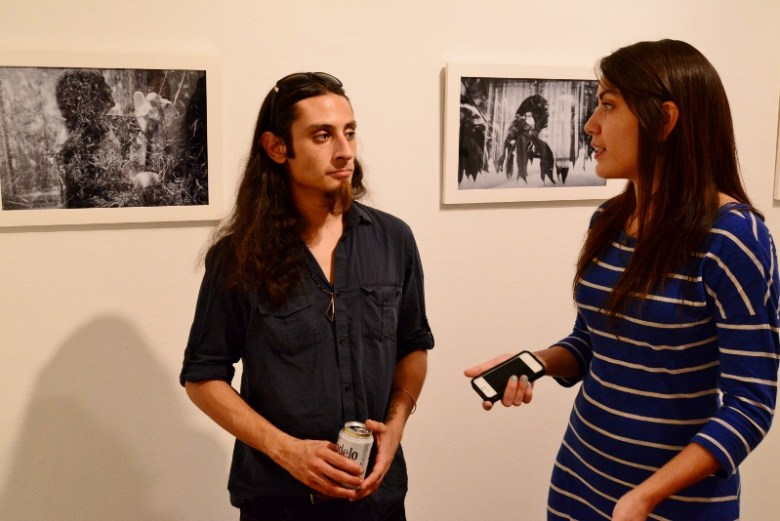 Artist Raul Castellanos and Jenelle Esparza discuss her exhibit. Photo by Page Graham.
