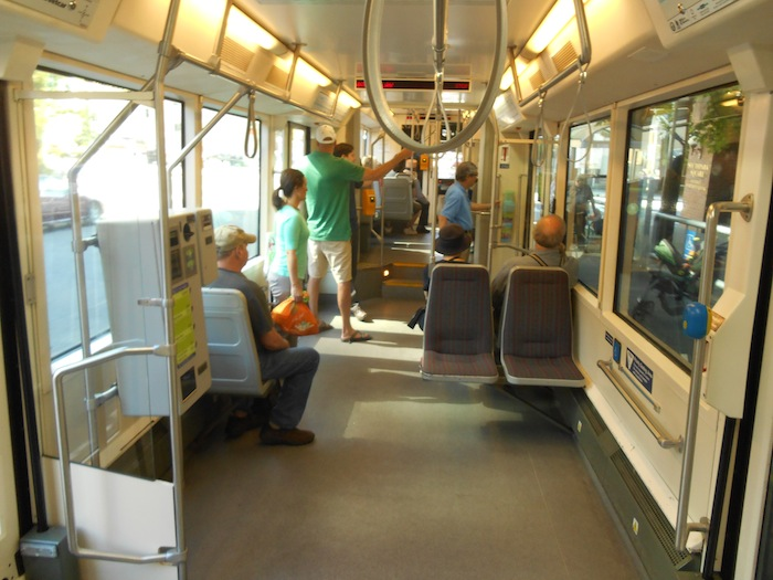 The streetcar has ample room for wheelchairs, strollers, or bicycles during midday. Photo by Don Mathis.