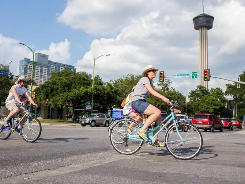 A group of cyclists cruise down South Alamo Street towards Southtown on the Fourth of July, 2014. Photo by Scott Ball.